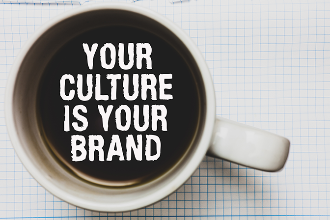 Looking down into a coffee cup the words your culture is your brand float on the coffee