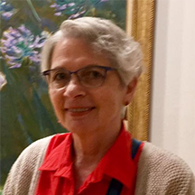 Woman with short gray hair smiling