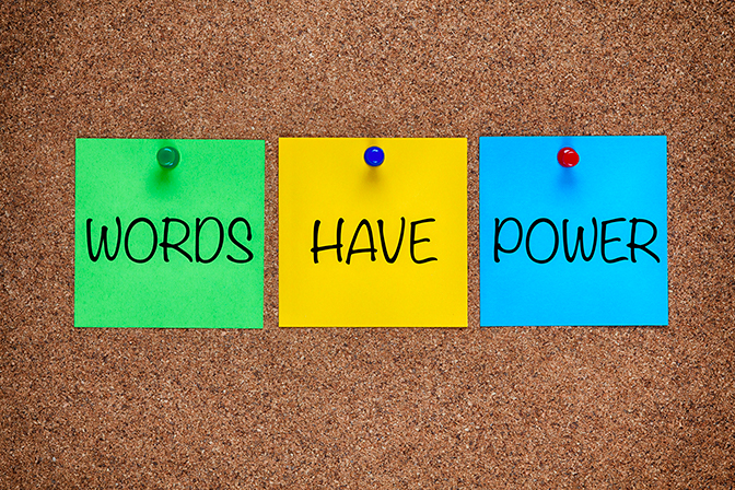 Three sticky notes on cork board read words have power